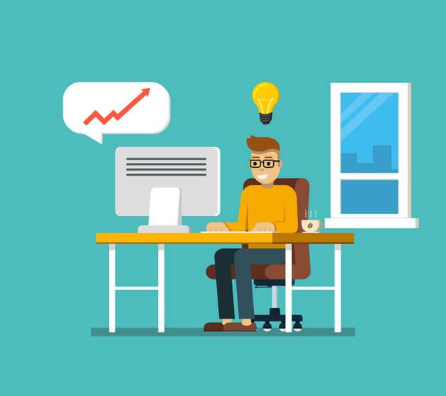 homem sentado de frente para um computador tendo uma ideia